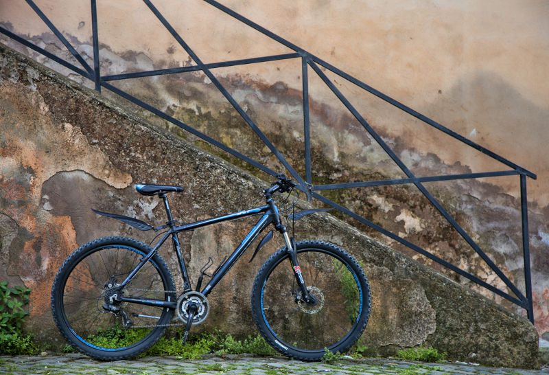 An Easy Bike Rent Mountain Bike with a typical vintage staircase in the background.