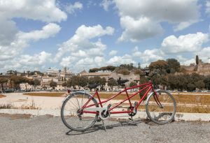 A Tandem Bike with the Circus Maximus and the Palatine Hill of Rome in the background.