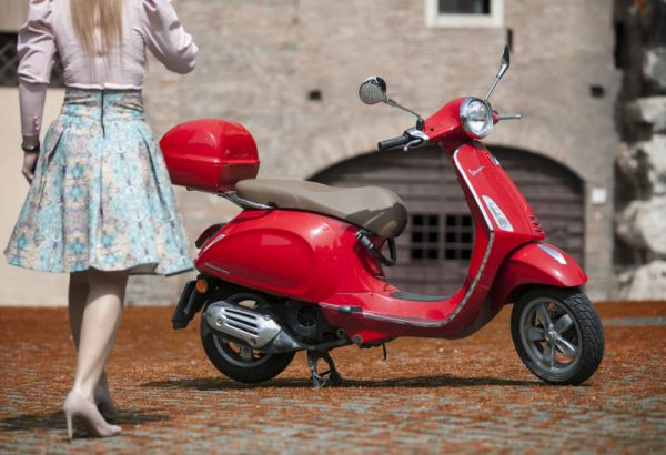 Red Vespa during a Vespa tour in Rome